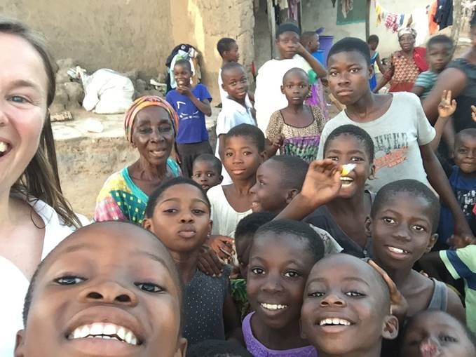 Librarian Lisa Goddard with a group of children in Banda, Ghana