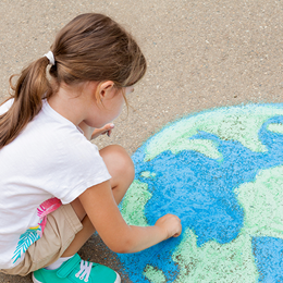 Child with Earth drawing